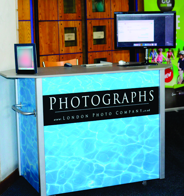 Link to a detailed description of vinyl graphics applied to London Photo Company's counter