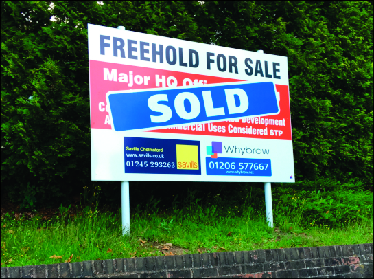 Aluminium Board adverting the sale of large headquarters building