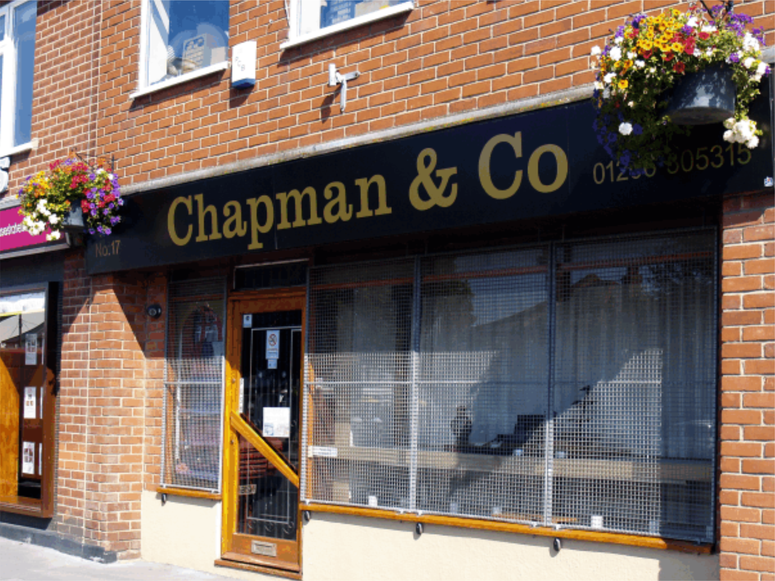 Chapmans Jewlers shop sign in Brightlingsea, Essex. Gold vinyl graphics were appleid to black aluminium composite sheets with folded returns. The sign was installed so that it covered the old storm damaged sign